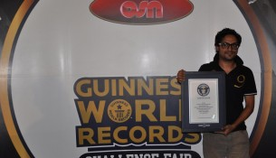 Shahan Haved holding his official Guinness World Records certificate