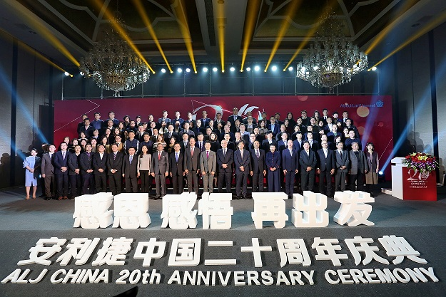 Management, partners, customers and staff celebrate 20 years of success and partnership for Abdul Latif Jameel Motors in China in November 2018