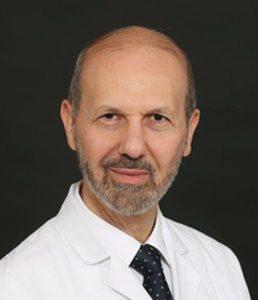 الدكتور عصام حماده، رئيس الجلسة، إستشاري الأمراض الجلدية بمستشفى الملك فيصل التخصصي وأستاذ الأمراض الجلدية بجامعة الفيصل